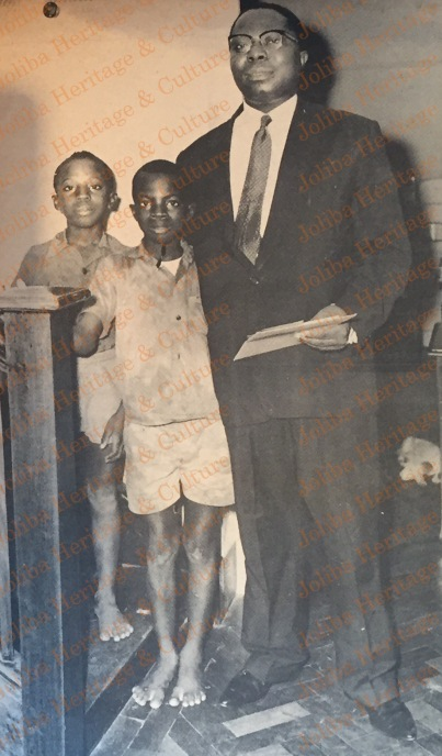 Justice Sowemimo with two of his children